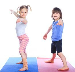 two kids doing yoga pose